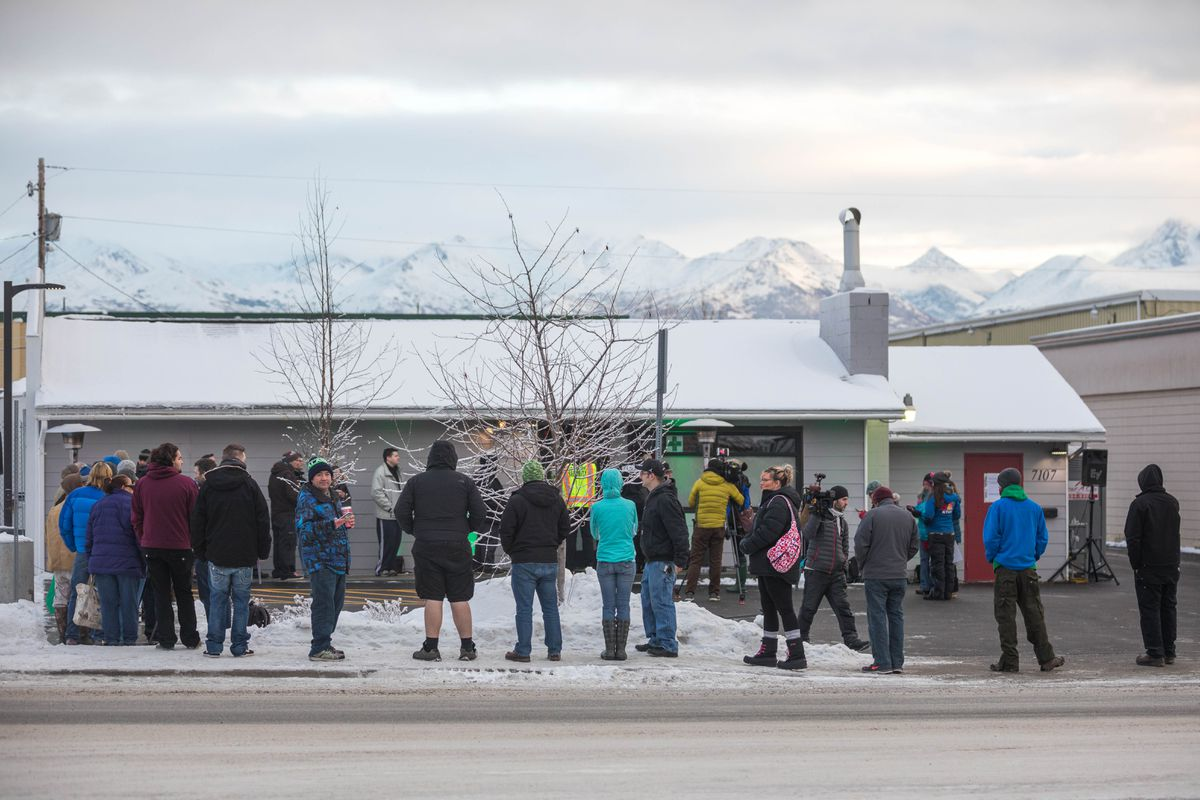 Customers wait to enter Arctic Herbery on Dec. 15. Arctic Herbery was the first marijuana shop to open in Anchorage. (Loren Holmes / ADN archive 2016)