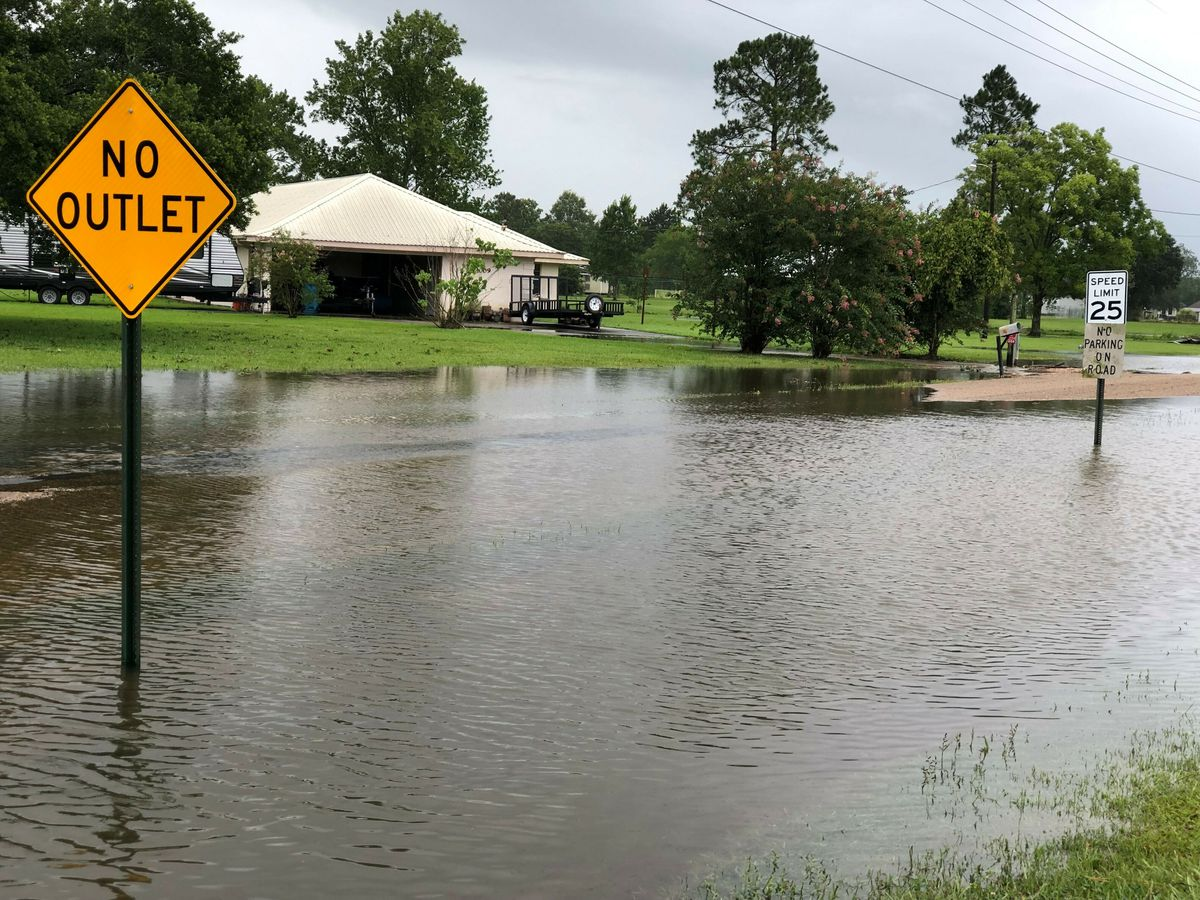Floodwater pools near homes in St. Martinville, La., Sunday, July 14, 2019, in the aftermath of Tropical Storm Barry. (Carrie Cuchens via AP)
