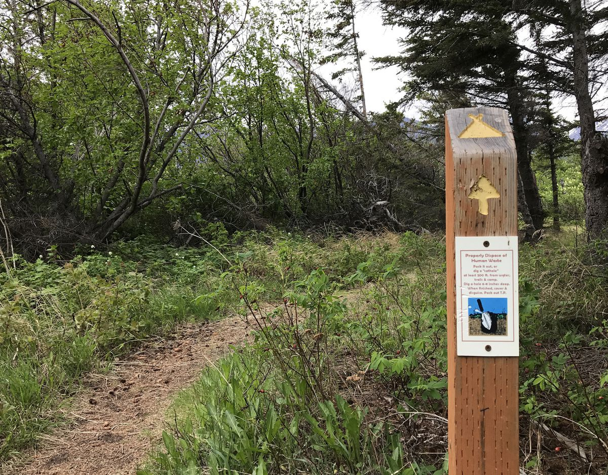 "A sign along the Gull Rock Trail out of Hope instructs hikers how to properly dispose of human waste: ""Pack it out, or dig a 'cathole' at least 200 feet from water, trails and camp. Dig a hole 6-8 inches deep. When finished, cover & disguise. Pack out T.P."" (Vicky Ho / Alaska Dispatch News)"