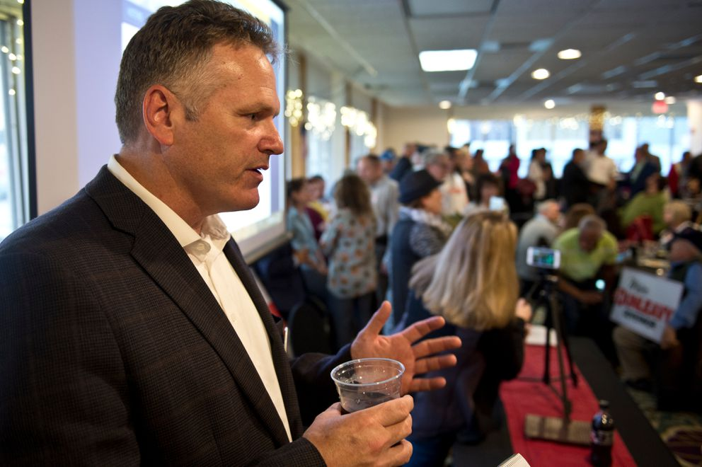 Mike Dunleavy, candidate for governor, talks with a reporter at a Republican party held at the Aviator Hotel on August 21, 2018. (Marc Lester / ADN)