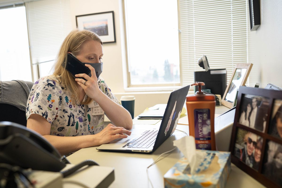 Anchorage School District nurse Bethany Zimpelman, part of the COVID-19 contact investigations and monitoring team, works in a borrowed office in the Municipality of Anchorage public health department building on April 16. (Loren Holmes / ADN archive)