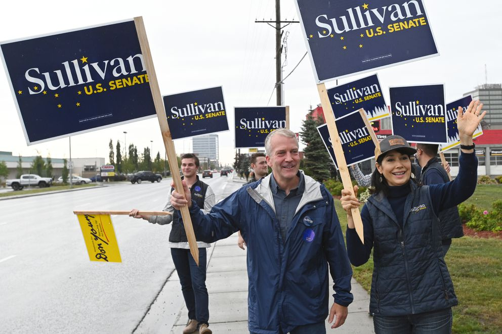 Sen. Dan Sullivan and his wife Julie Fate Sullivan campaigned at the corner on Seward Highway and Northern Lights Boulevard during the primary election on Tuesday, August 18, 2020. (Bill Roth / ADN)