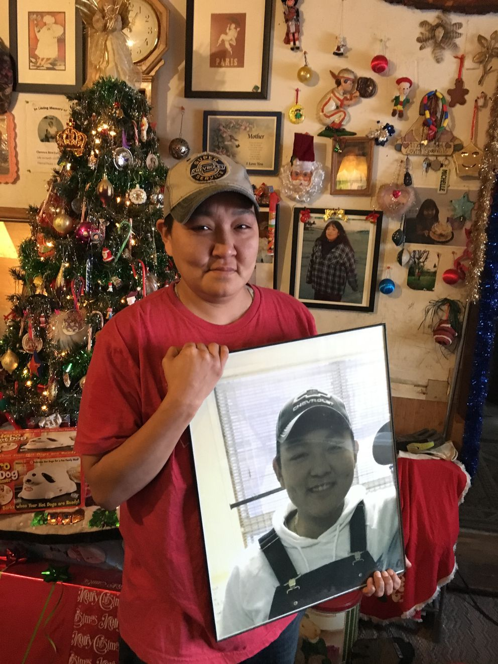 Michelle Woodford holds a portrait of her son Frank Woodford in her home in Caswell Lakes on Jan. 2, 2017. Frank died in June after being shot. (Zaz Hollander / Alaska Dispatch News)