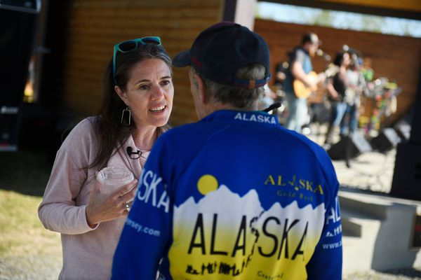 Anne Zink, Alaska's chief medical officer, speaks with Ron Levy at Soldotna Creek Park on May 26, 2021. Zink took a two-day road trip to talk about the COVID-19 vaccine and meet with healthcare workers. (Marc Lester / ADN)