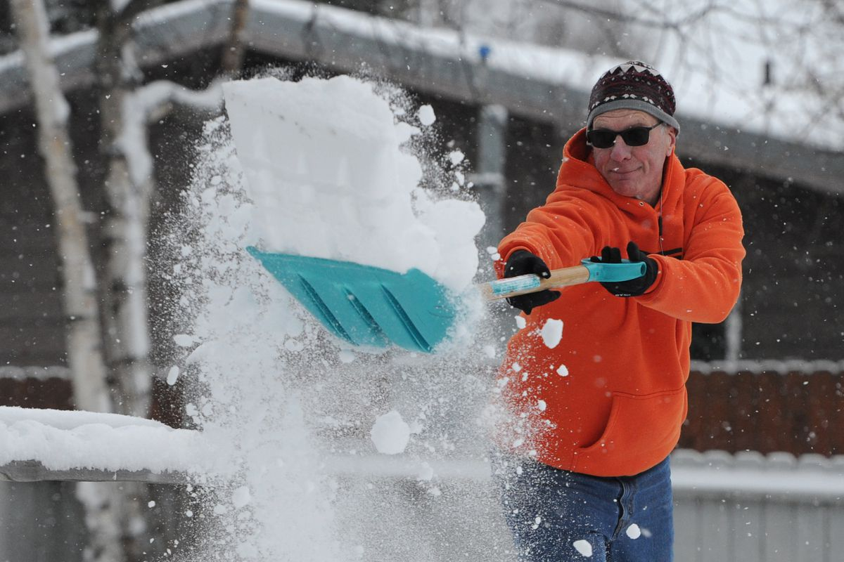 Mark Rhodes shovels snow from the driveway at his Midtown home on Wednesday, ahead of Friday's big snow dump. With all the new snow Rhodes said he is ready to go skiing. (Bill Roth / ADN)