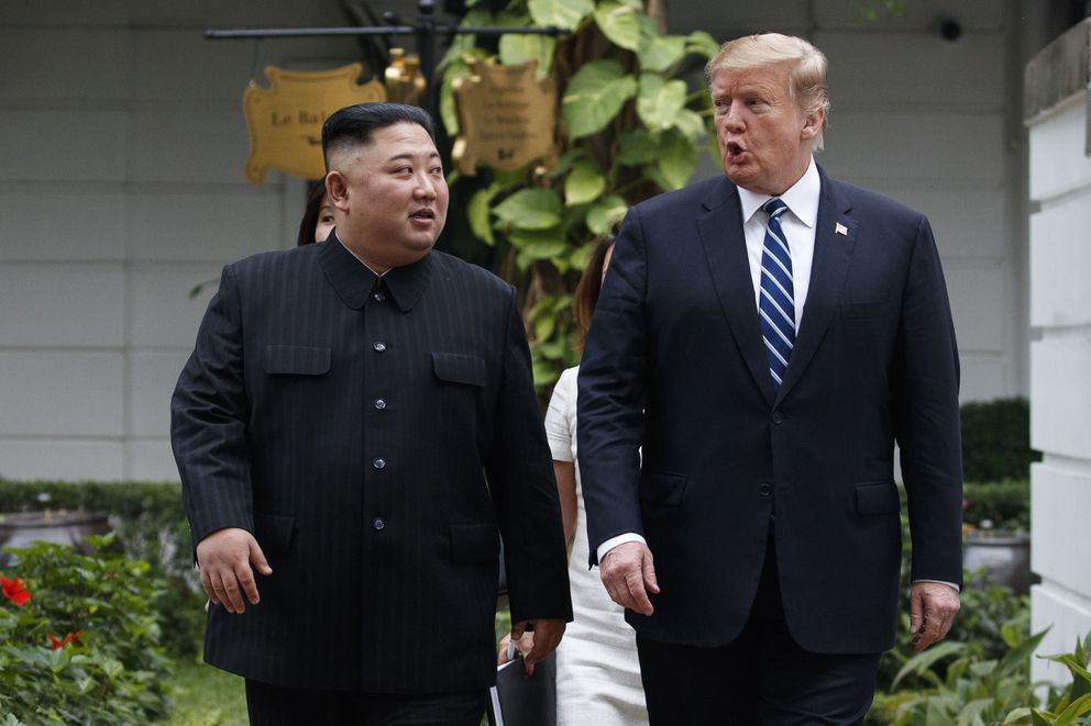 FILE - In this Feb. 28, 2019, file photo, U.S. President Donald Trump, right, and North Korean leader Kim Jong Un take a walk after their first meeting at the Sofitel Legend Metropole Hanoi hotel, in Hanoi.(AP Photo/Evan Vucci, File)