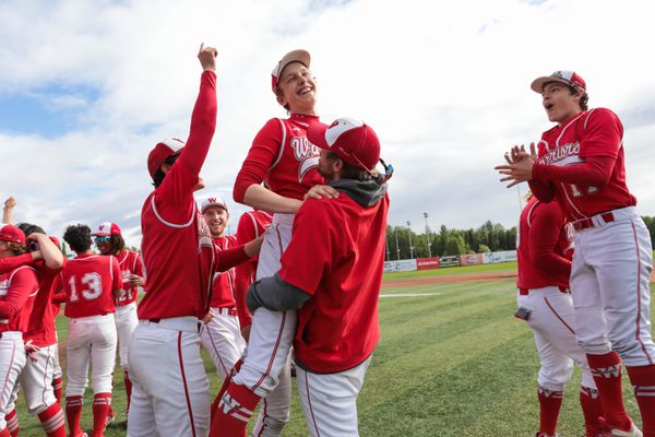 Wasilla pitcher Caleb Colegrove is lifteb up by a coach after Wasilla won the state championship baseball game against Ketchikan Saturday, June 1, 2019 at Mulcahy Stadium. (Loren Holmes / ADN)