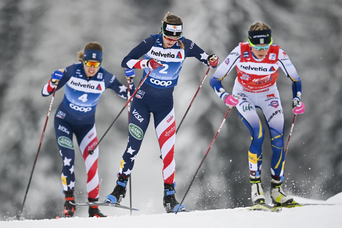 Rosie Brennan of Anchorage, left, Jessie Diggins of Minnesota, center, and Frida Karlsson of Sweden lead the pack in the women's 10K freestyle pursuit race Sunday in the Tour de Ski. (Gian Ehrenzeller/Keystone via AP)
