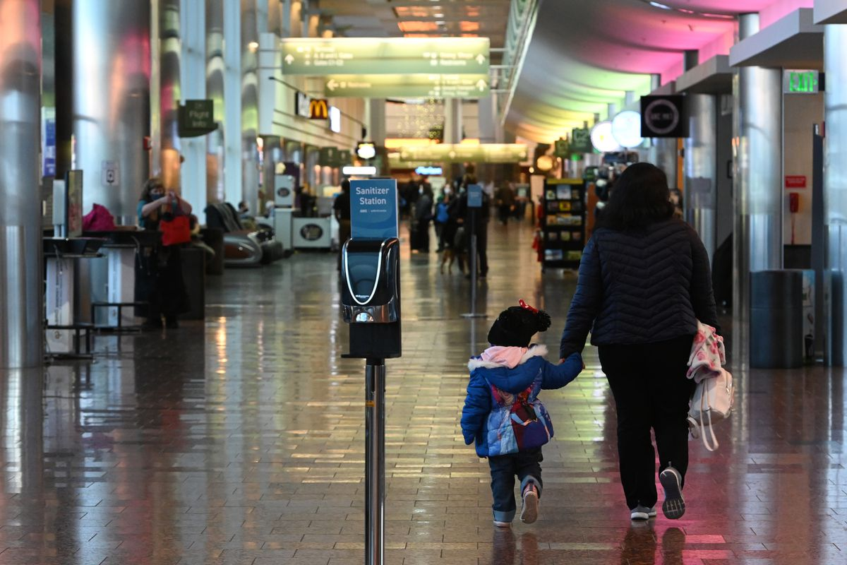 Sanitizer stations are available to air travelers walking through Ted Stevens Anchorage International Airport on Thursday, Nov. 19, 2020. (Bill Roth / ADN)