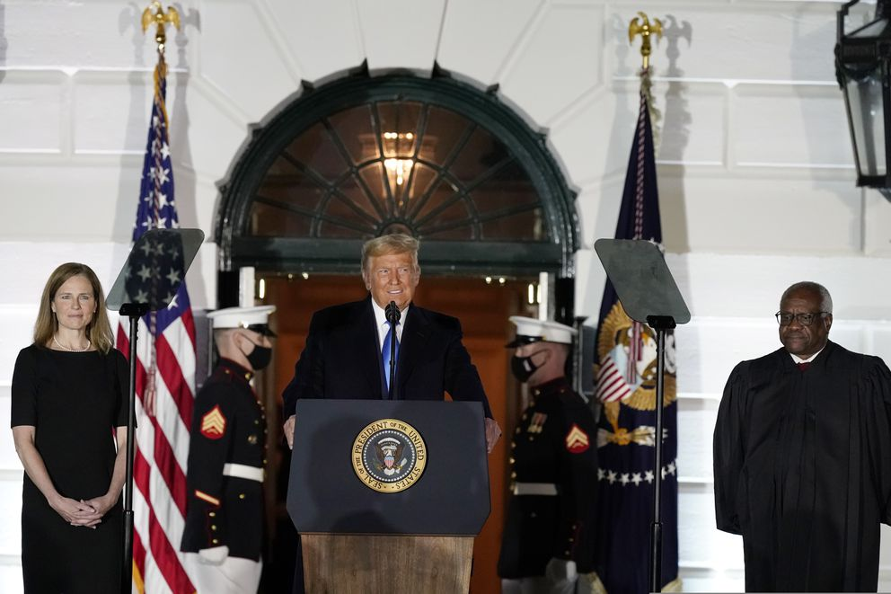 President Donald Trump speaks before Supreme Court Justice Clarence Thomas administers the Constitutional Oath to Amy Coney Barrett on the South Lawn of the White House White House in Washington, Monday, Oct. 26, 2020, after Barrett was confirmed to be a Supreme Court justice by the Senate earlier in the evening. (AP Photo/Alex Brandon)