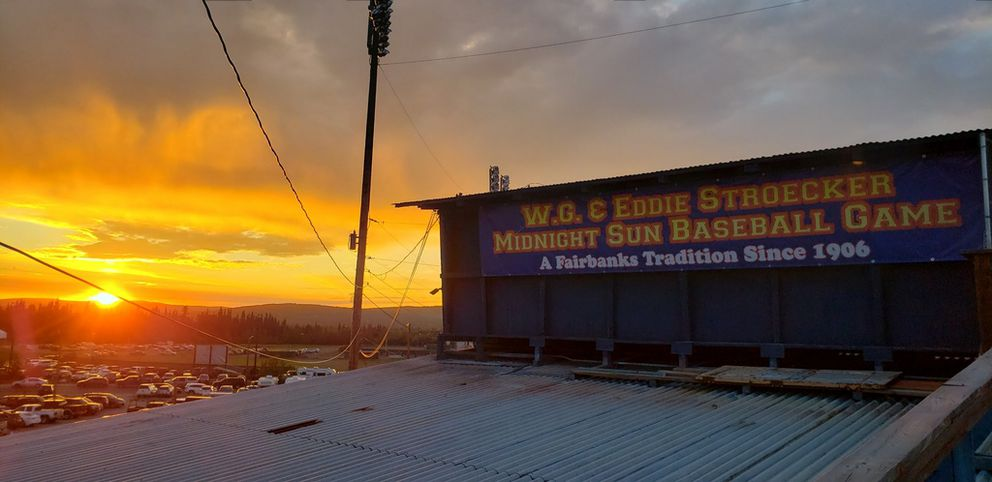 The sun shines over the Growden Memorial Park press box at midnight on June 21, 2019, during the 114th annual Midnight Sun Game. (Shawna Sastamoinen photo)