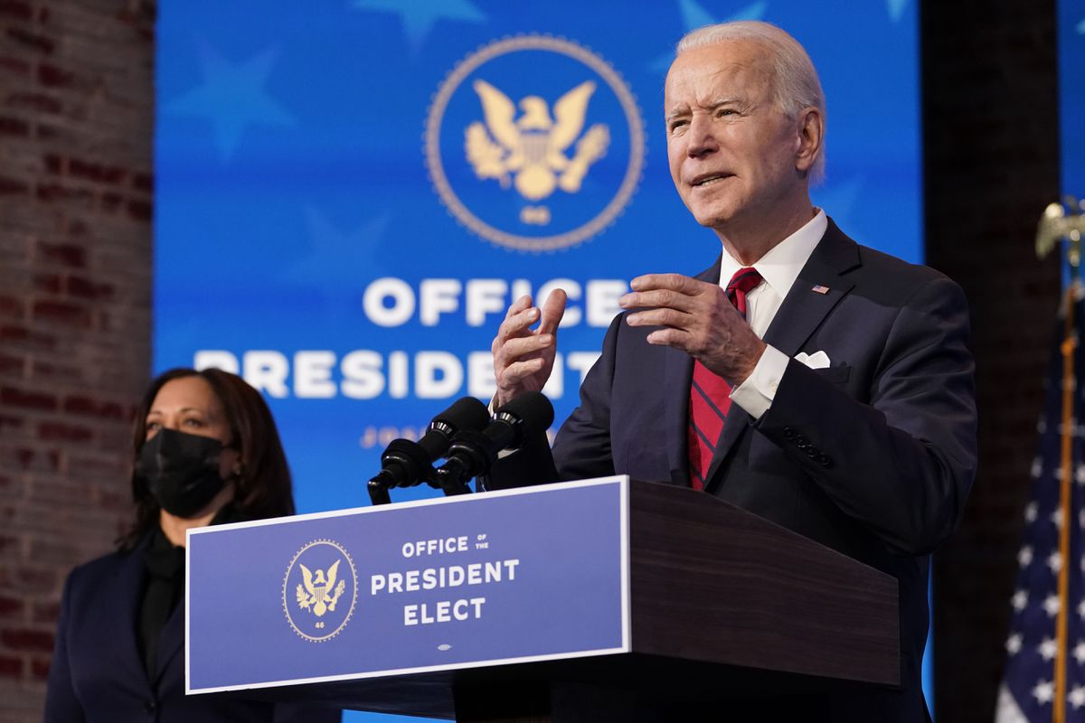 Vice President-elect Kamala Harris listens as President-elect Joe Biden speaks during an event at The Queen theater, Friday, Jan. 15, 2021, in Wilmington, Del. (AP Photo/Matt Slocum)