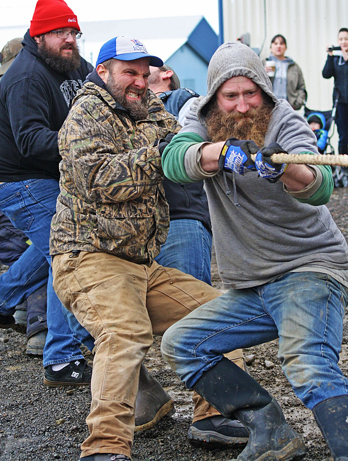 From left to right, Tyler Bishop, Clint Reigh and Tyler McWilliams show the strain in the men's tug-of-war competition during Beaver Roundup in February 2015.(Clark Fair)
