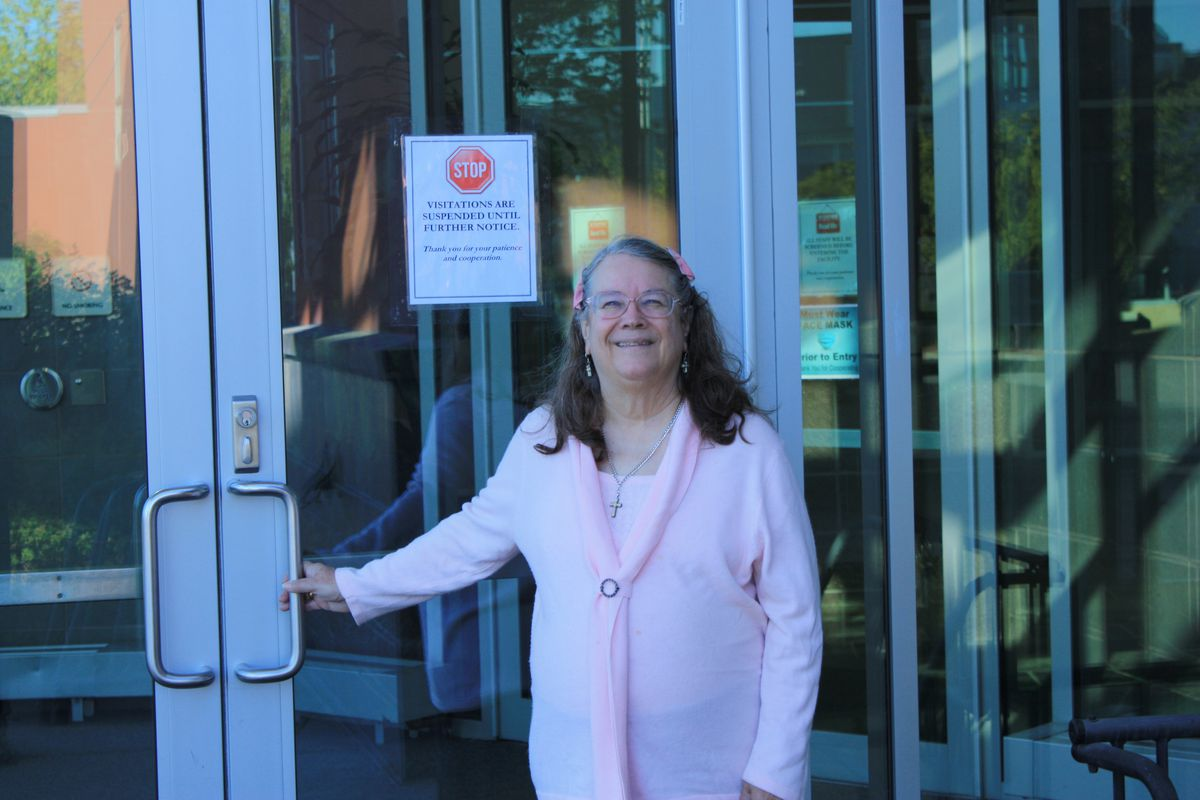 Faith Myers stands at the entrance to Alaska Psychiatric Institute. (photo courtesy Faith Myers)