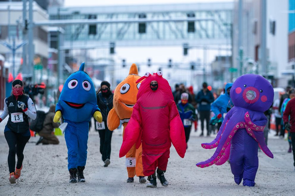 Runners dressed in sea creature costumes participate in the Fur Rondy Frostbite Footrace on Saturday, Feb. 27, 2021 in downtown Anchorage. (Loren Holmes / ADN)