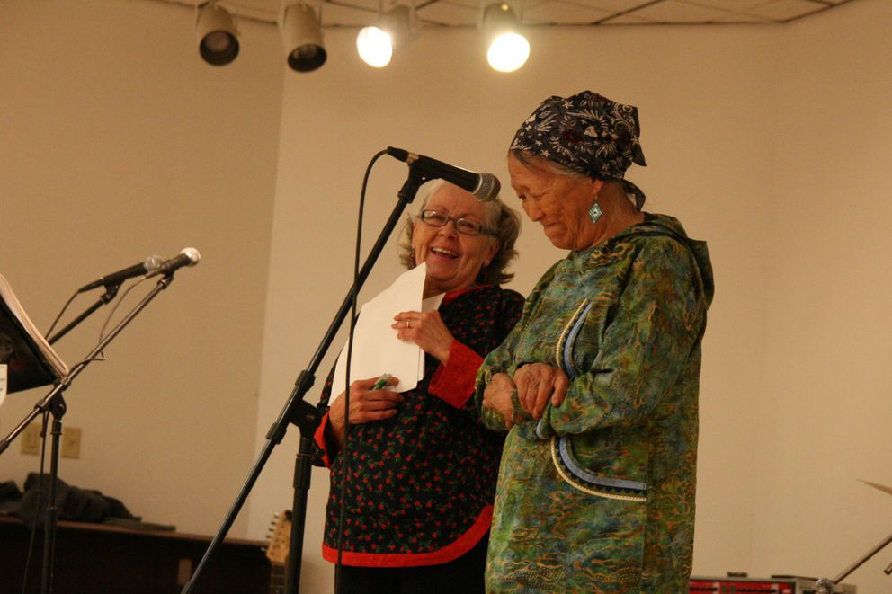 Lydia Wheeler thanks the crowd with friend Gloria Simeon by her side on Saturday, Aug. 13, 2016, at a fiddle dance in Bethel, Alaska. Simeon organized the dance as a community fundraiser to help Wheeler furnish her new home. (Lisa Demer / Alaska Dispatch News)
