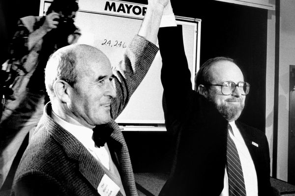 FILE - In this Nov. 3, 1987, file photo, Republican Tom Fink, left, celebrates after winning the runoff election in Anchorage, Alaska, for Anchorage mayor by more than 7,000 votes. Fink is with Democrat Dave Walsh, who conceded the election about two hours after the polls closed, holding Fink's arms up in a victory salute. Fink, a former speaker of the Alaska House of Representatives who later became mayor of Anchorage, has died. He was 92. Fink died of