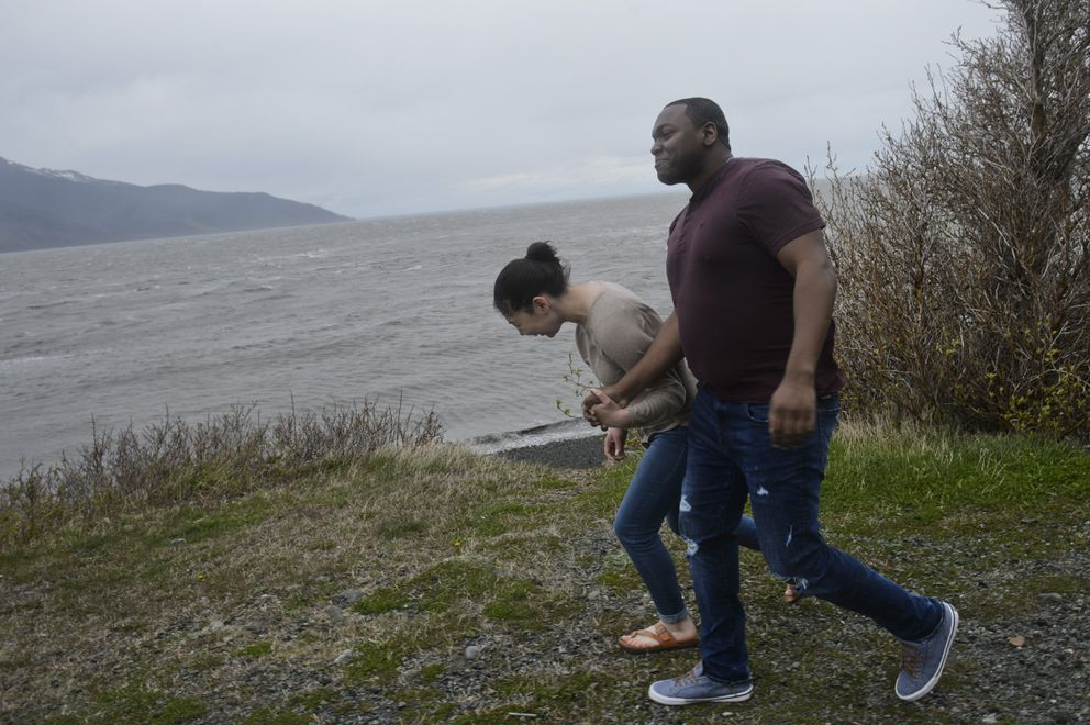Roger Turner and Raegan Lowe brave the wind on Turnagain Arm to take in the view at Beluga Point Friday afternoon. (Marc Lester / ADN)