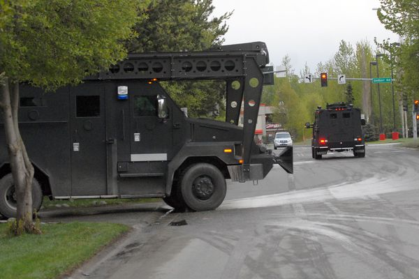 Police SWAT vehicles leave an RV park on Hoyt Street in Anchorage, where officers staged during a standoff in with an armed man at a home in a nearby neighborhood on Friday, May 17, 2019. Police said the man was taken into custody at around 6:35 a.m. Friday. (Matt Tunseth / ADN)