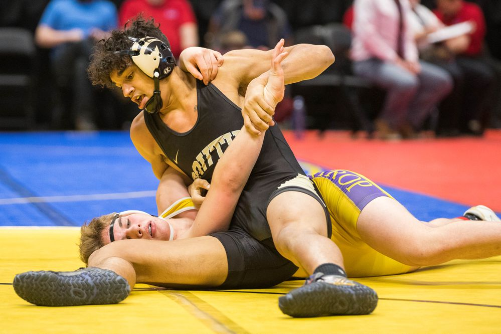 South's Dorian Mellon tries to pin Lathrop's Sean Michel during the state high school wrestling tournament Saturday, Dec. 15, 2018 at the Alaska Airlines Center. (Loren Holmes / ADN)