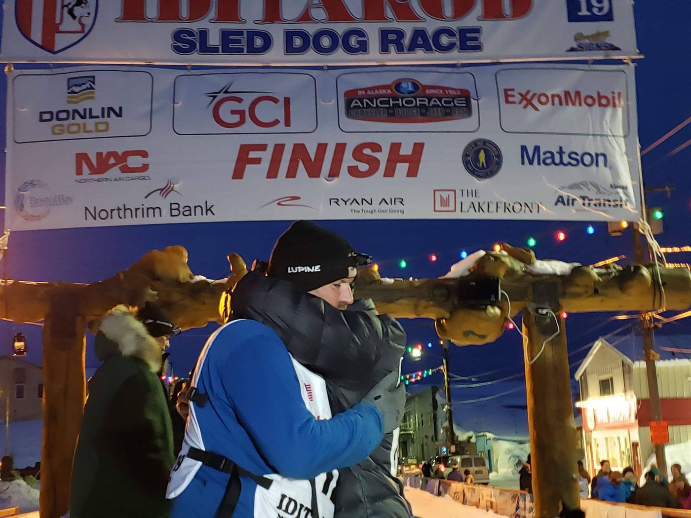 Jason Campeau, left, hugs his brother Jody Campeau at the finish line of the Iditarod in Nome on March 25, 2019. (Jody Campeau photo)