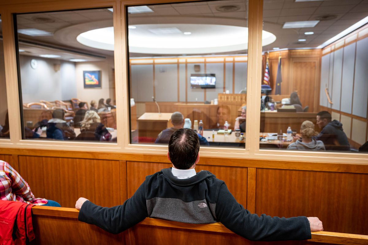 People watch a live video feed of the Anthony Pisano murder trial in a basement courtroom on March 18, 2020 at the Nesbett Courthouse in Anchorage. It was one of the last trials before the system essentially shut down because of the pandemic. (Loren Holmes / ADN)