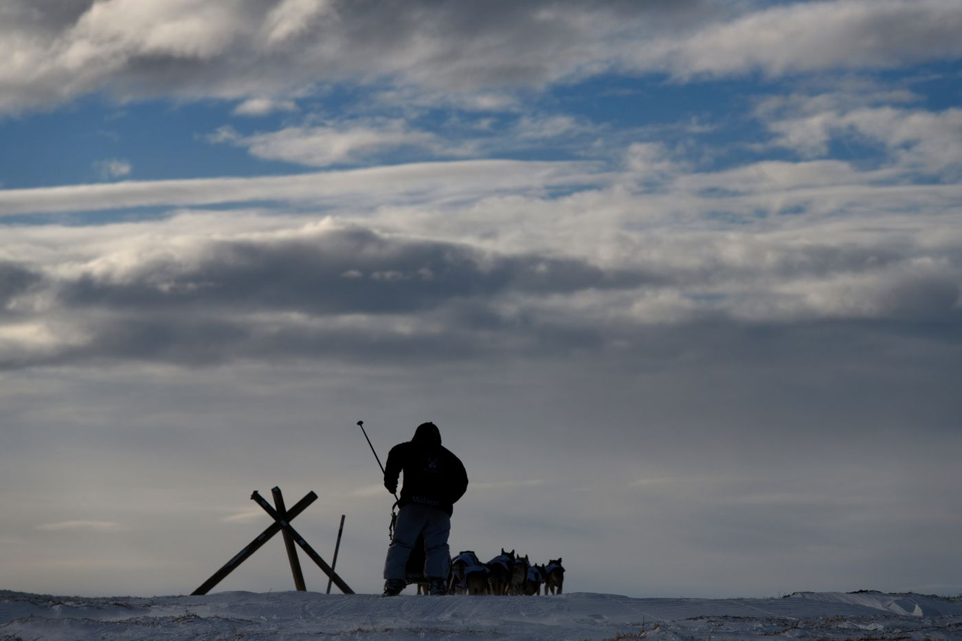 Allen Moore passes Eagle Summit and begins the descent toward the Mile 101 checkpoint of the Yukon Quest International Sled Dog Race on February 10, 2019. (Marc Lester / ADN archive)