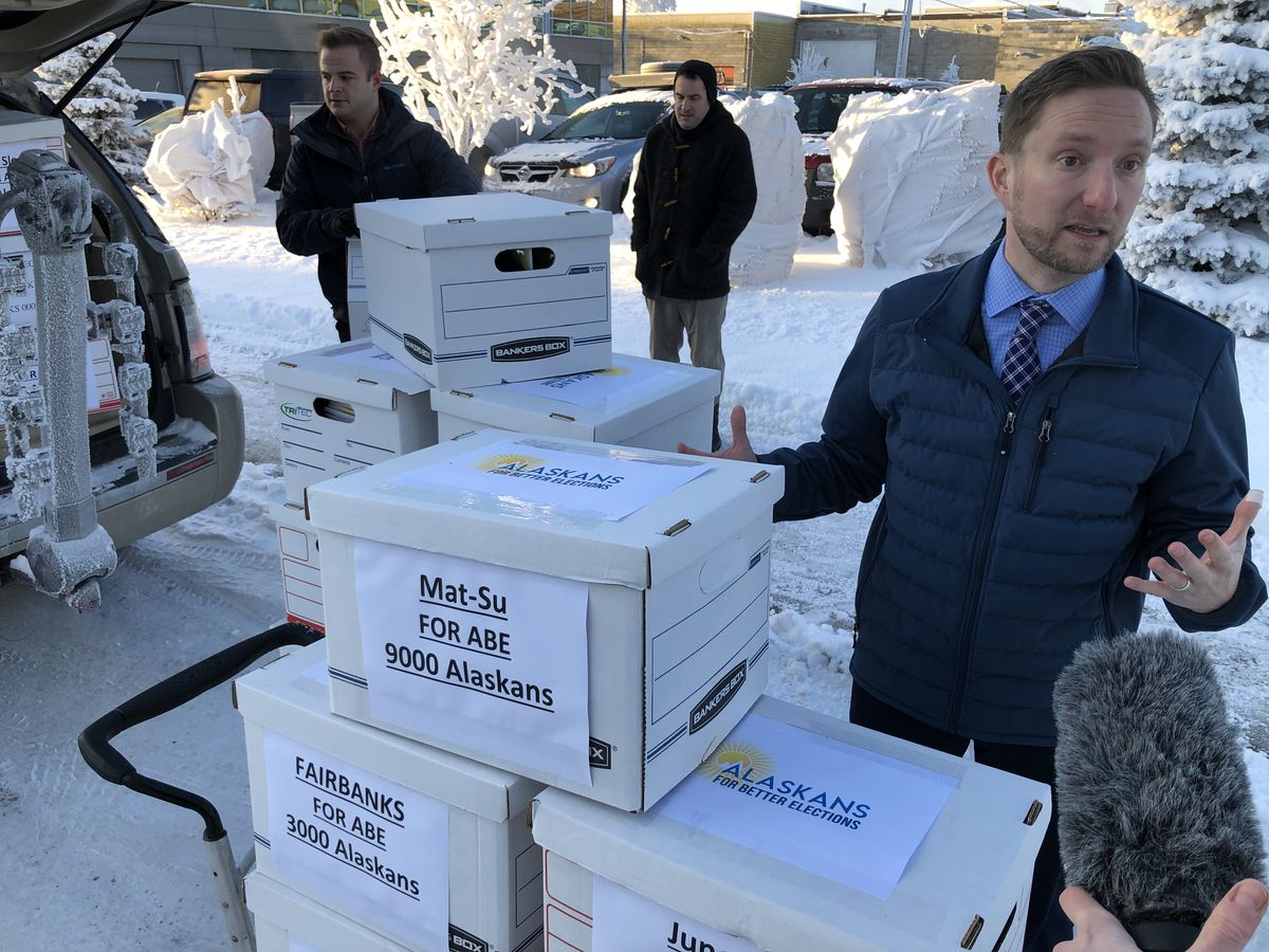 Former state Rep. Jason Grenn, co-chair of Alaskans for Better Elections, turns in 41,068 signatures as part of a ballot measure campaign Jan. 9, 2019 at the Alaska Division of Elections. (James Brooks / ADN archive)