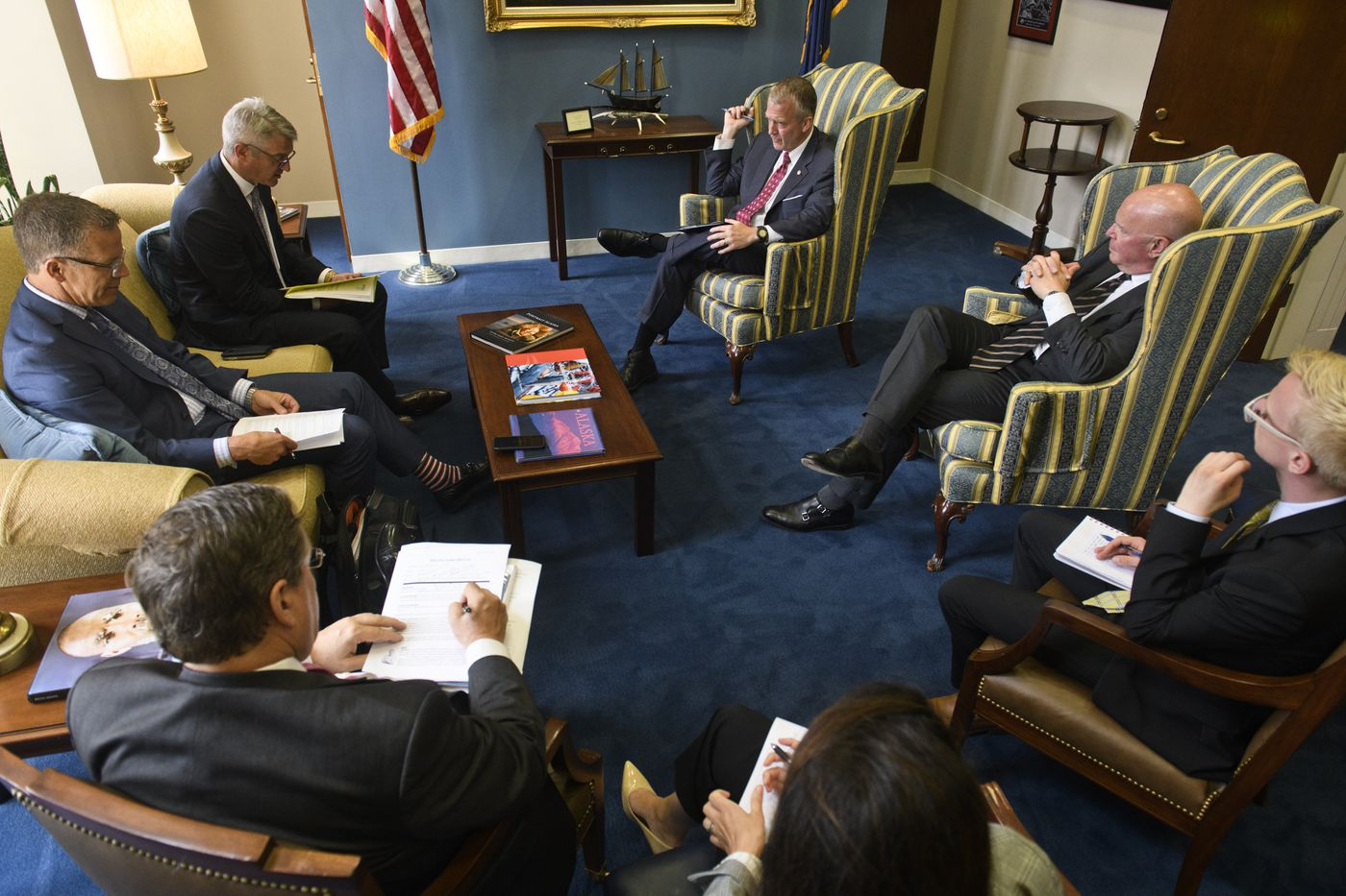Sen. Dan Sullivan, top right, talks with Primera Blue Cross vice president for congressional and legislative affairs Gary Stranigan, left, and CEO Jeff Roe, second from left, during a meeting in Sullivan's Washington office on June 19, 2019. (Marc Lester / ADN)