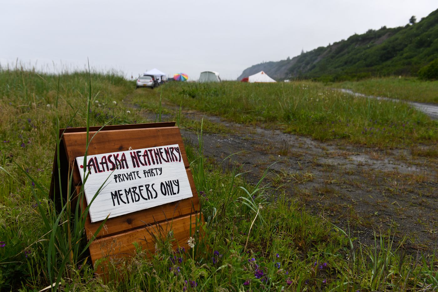 A sign directs members to the Alaska Heathenry camp on June 21, 2018.(Marc Lester / ADN)