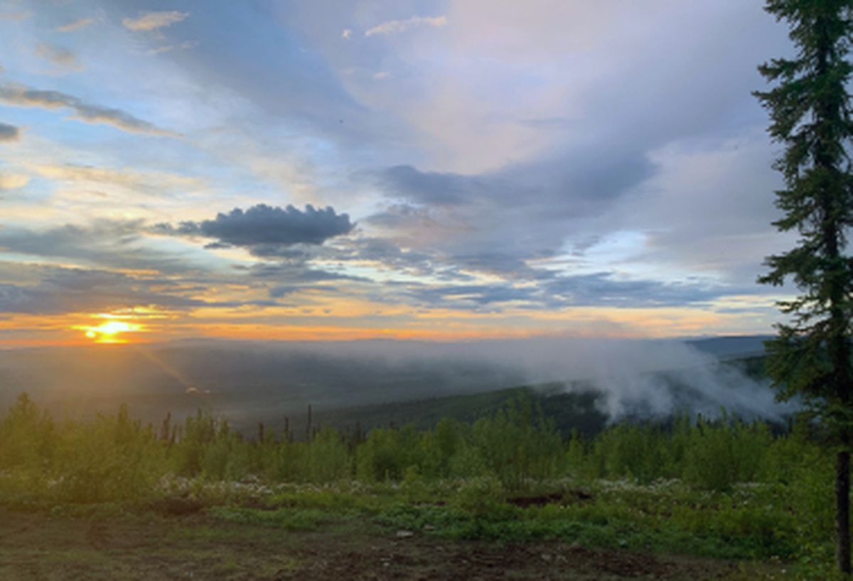 Light smoke from the Any Creek Fire burning near Old Murphy Dome Road north of Fairbanks rises late Saturday night following an aggressive aerial and ground assault. (Photo by Thomas Krock/Alaska Division of Forestry)