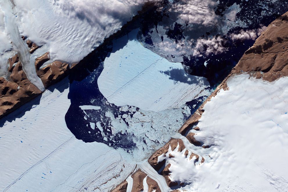 This NASA Earth Observatory image obtained July 27, 2012, shows a massive ice island as it broke free of the Petermann Glacier in northwestern Greenland. MUST CREDIT: Handout photo by Jesse Allen and Robert Simmon/NASA Earth Observatory
