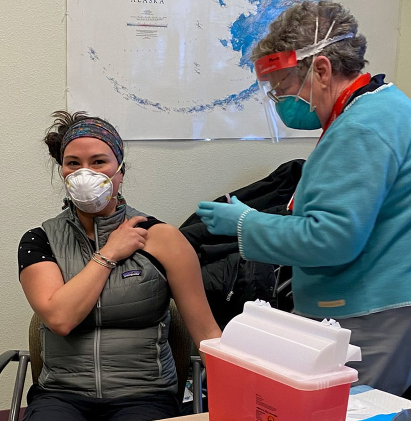 Tanya Salmon, a Southcentral Foundation community health aide in Igiugig, gets vaccinated against COVID-19 in Iliamna on Tuesday, Jan. 5, 2021. (Southcentral Foundation photo)