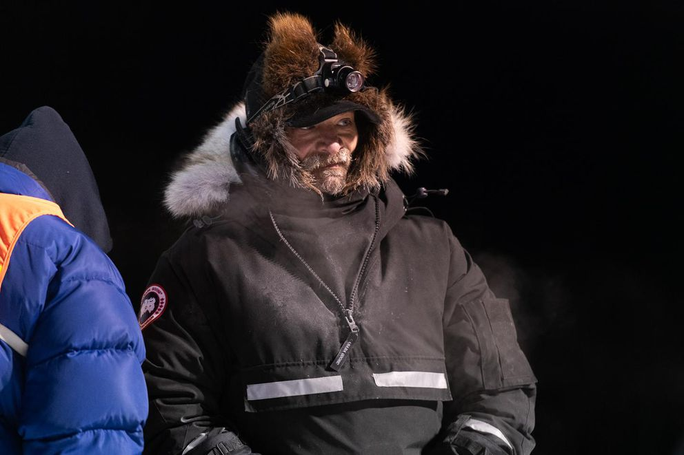 Lance Mackey stands ready with his team in the chute at the start of the Kuskokwim 300 Sled Dog Race on January 17, 2020 in Bethel, Alaska. (Photo by Katie Basile / KYUK Public Media)