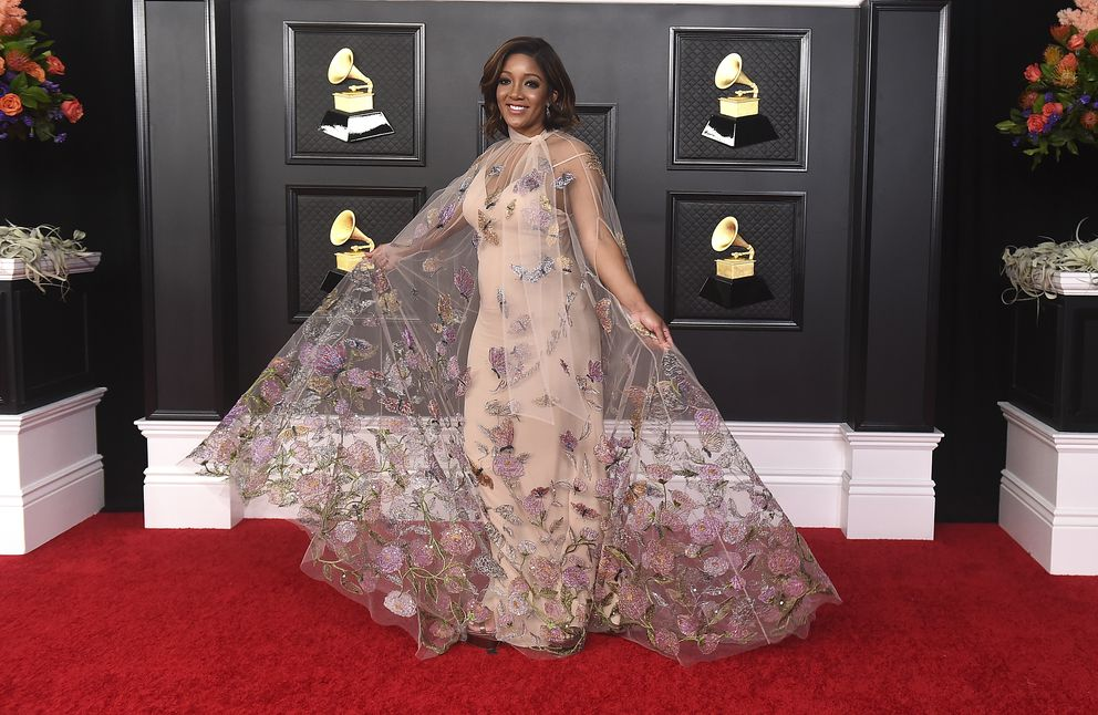 Mickey Guyton poses on the press line at the 63rd Grammy Awards at the Los Angeles Convention Center on Tuesday, March 9, 2021. The award show airs on March 14 with both live and prerecorded segments. (Jordan Strauss/Invision/AP)