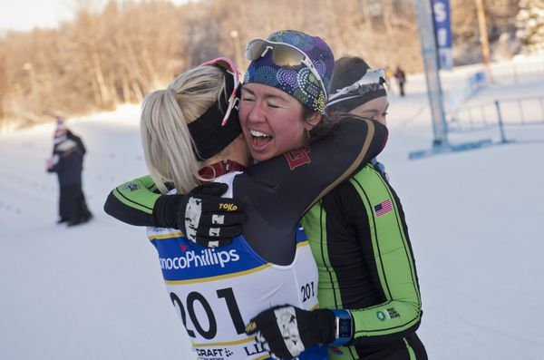 Caitlin Patterson, right, of Craftsbury GRP, is congratulated on her classic sprint title by Jasmi Joensuu of the University of Denver. (Marc Lester / ADN)