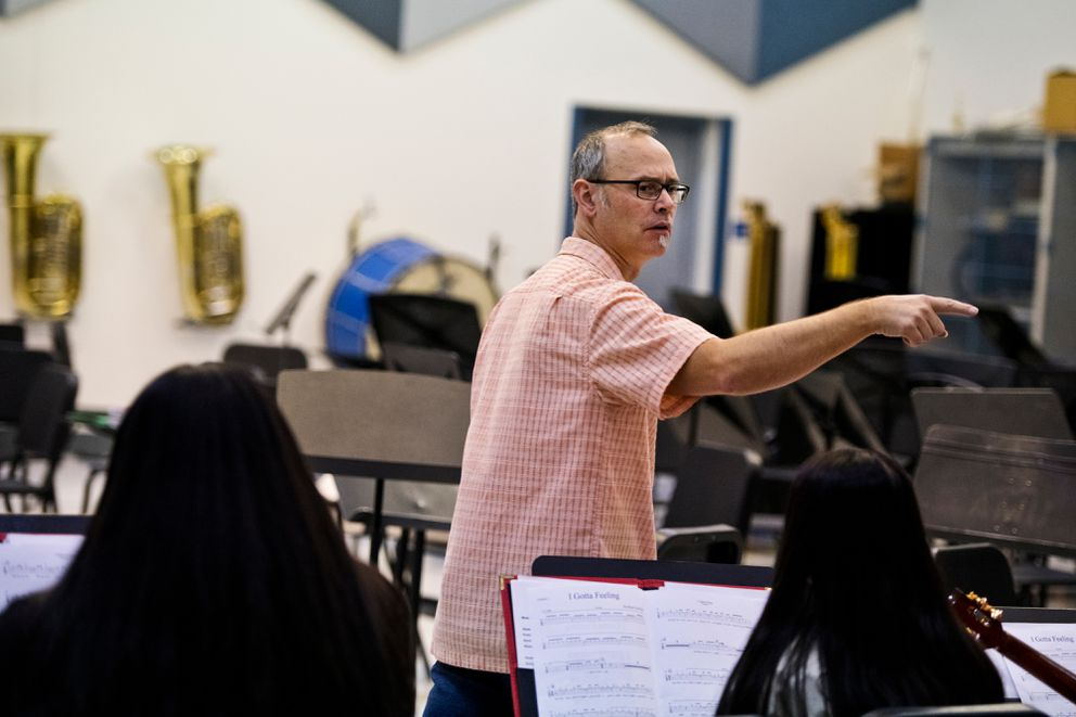 East High music teacher Kiel Schweizer conducts the school's ukulele orchestra on Nov. 19. (Marc Lester / ADN)