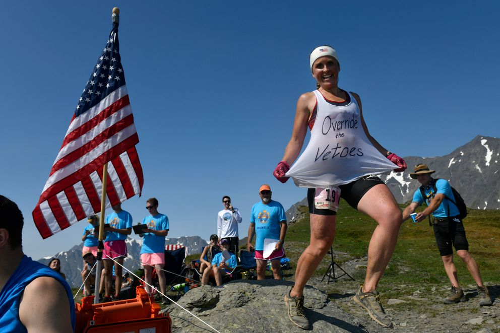 Holly Brooks, of Anchorage, shows a message on her shirt while competing in the Mount Marathon women's race on July 4, 2019, in Seward. (Marc Lester / ADN)