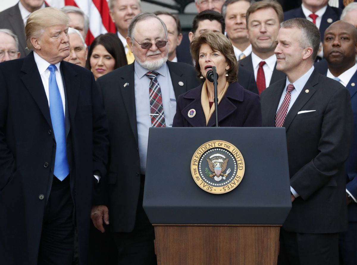 President Donald Trump stands with Alaska Republican Sen. Lisa Murkowski, Rep. Don Young and Sen. Dan Sullivan after Congress passed sweeping tax overhaul legislation on the South Lawn of the White House, Dec. 20, 2017. REUTERS/Jonathan Ernst