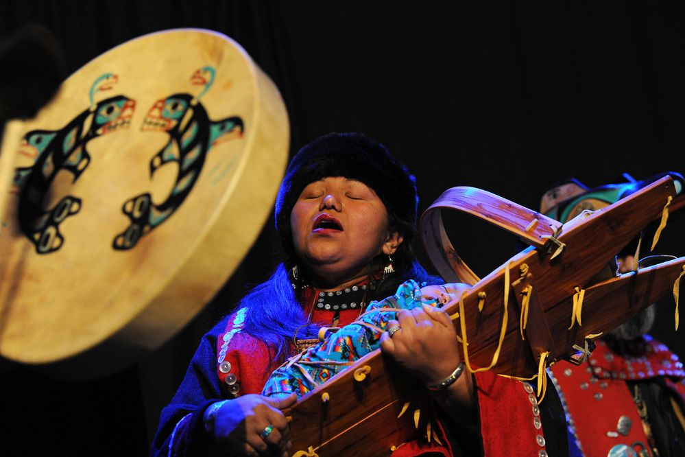 Mary Soots holds Noah Soots in a cradleboard as she performs with the Naa Luudisk Gwaii Yatx'I dance group during Quyana at the Alaska Federation of Natives at the Dena'ina Center in downtown Anchorage, AK on Friday, Oct 19, 2018. (Bob Hallinen / ADN)