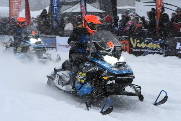 Iron Dog pro class team #8 of Tyler Aklestad, right, and Tyson Johnson leave the start at Deshka Landing during a snowstorm in Willow on Sunday, Feb. 17, 2019. (Bill Roth / ADN)