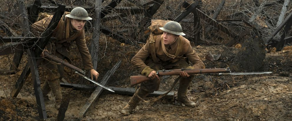 This image released by Universal Pictures shows Dean-Charles Chapman, left, and George MacKay in a scene from '1917, ' directed by Sam Mendes. (François Duhamel/Universal Pictures via AP)