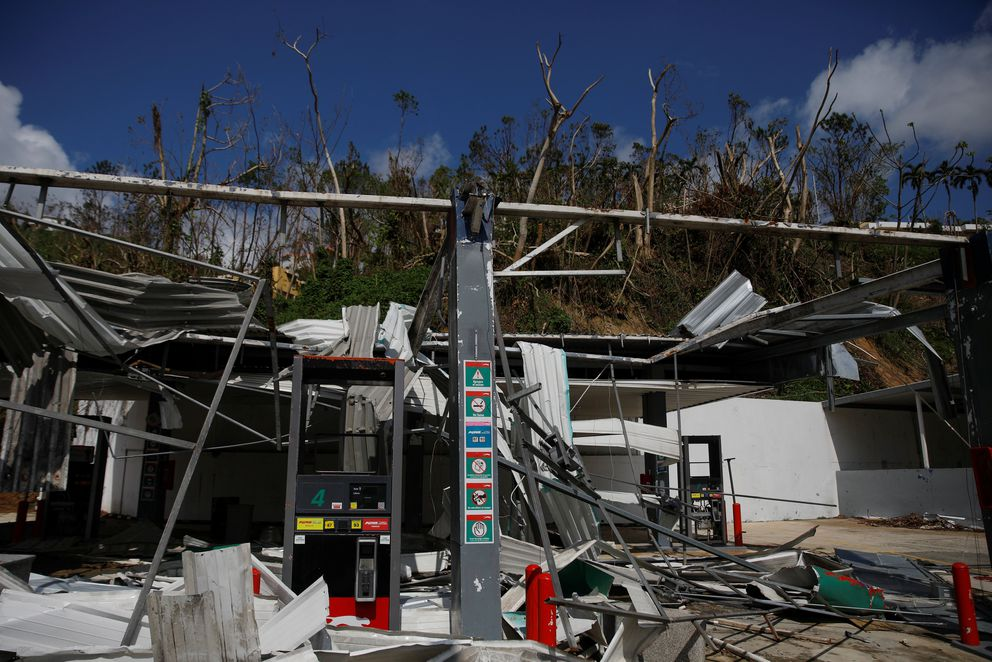 A gas station sits in ruins, after Hurricane Maria, in the municipality of Naranjito outside San Juan, Puerto Rico, October 11, 2017. REUTERS/Shannon Stapleton