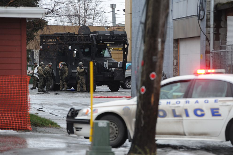 A suspect peacefully surrendered and was arrested by Anchorage Police SWAT officers during a standoff at the Backpackers Inn on Sunday, Nov. 18, 2018. (Bill Roth / ADN)