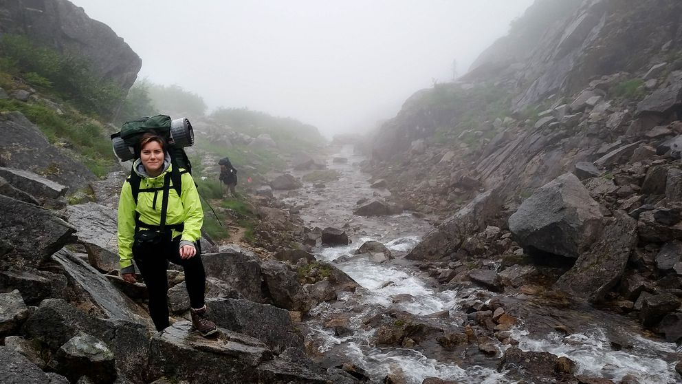 """In 2016, more than10,000 people day-hiked or backpacked the Chilkoot Trail. This hiker pauseson Long Hill before the famous """"Golden Stairs"""" in 2015. (Shannon Millard / NPS)"""