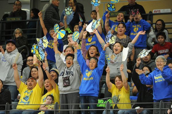 The Nunamiut High School Amaguqs fans celebrate their team's win over The Nikolaevsk Highs School Warriors 56 to 42 in a 2nd round game in the 1A boys Alaska State basketball tournament at the UAA Alaska Airlines Center in Anchorage, Alaska on Thursday, March 15, 2018. (Bob Hallinen / ADN)
