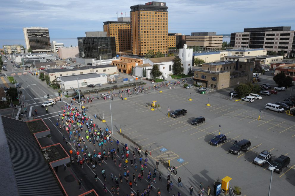 Half marathon competitors run through downtown Anchorage. (Bill Roth / ADN)