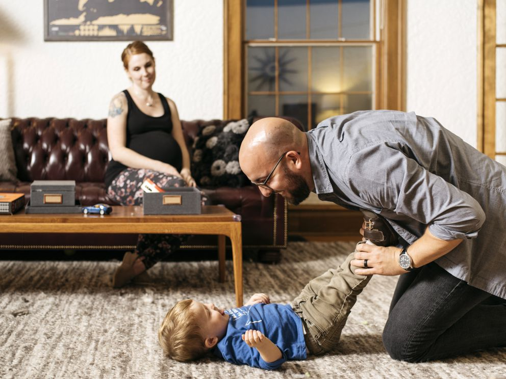 PARCHMENT, MI - OCTOBER 8: Sara Dean and her husband, Matt, play with their 2-year-old son, Patrick, after dinner at their home in Parchment, Mich., on Oct. 8, 2018. (Photo for The Washington Post by David Kasnic)