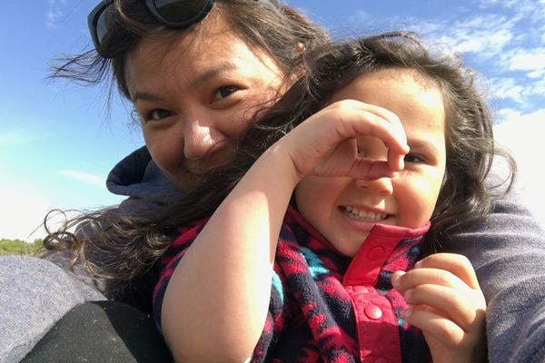 Laureil Ivanoff, left, with her young friend Niv. After spending four days with Niv, Ivanoff says she learned more Inupiaq than she had from any other teacher. (Courtesy of Laureil Ivanoff)