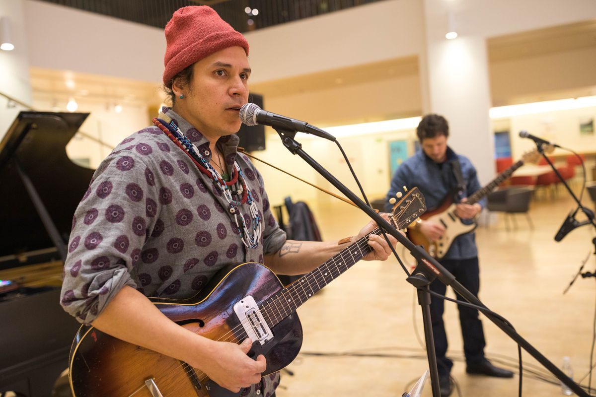 Nicholas Galanin, left, and Zak Wass of Indian Agent play at a sound check on Friday, Feb. 8, at the Anchorage Museum. The band is one of the artists featured on the album